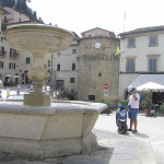 Fountain, in the background the round tower of the walls, Cetona, Siena. Author and Copyright Marco Ramerini