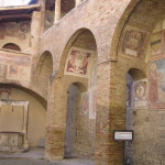 Frescos en el patio del Palazzo del Popolo, Piazza del Duomo, San Gimignano, Siena. Author and Copyright Marco Ramerini