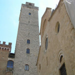 The facade of the Duomo and the Torre Grossa, Piazza del Duomo, San Gimignano, Piazza del Duomo, San Gimignano, Siena. Author and Copyright Marco Ramerini