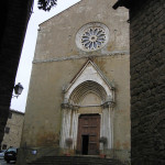 La facciata romanico gotica della chiesa dei Santi Leonardo e Cristoforo, Monticchiello, Val d'Orcia, Siena. Author and Copyright Marco Ramerini
