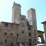 The houses Semplici and Magazzini and towers Ardinghelli, Piazza della Cisterna, San Gimignano, Siena. Author and Copyright Marco Ramerini
