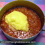 Aggiunta della polpa delle zucchine al sugo di carne per le Zucchine Ripiene. Autore e Copyright Marco Ramerini.