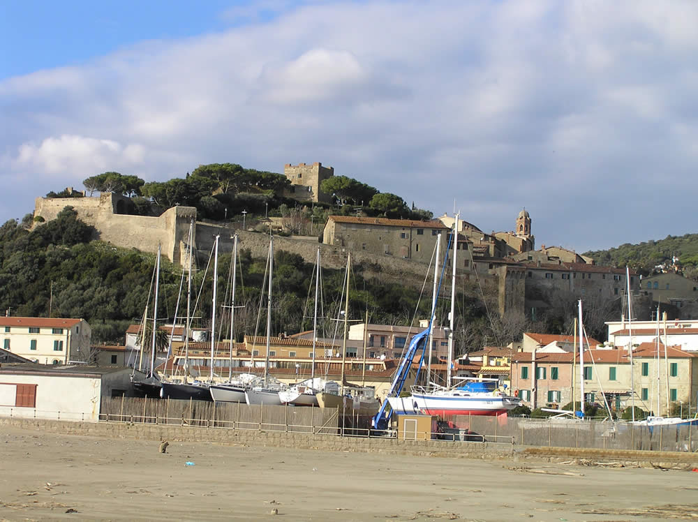 The port and the ancient village of Castiglione della Pescaia. Author and Copyright Marco Ramerini