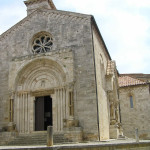 Facciata della Collegiata con il magnifico portale romanico del XII secolo, San Quirico d'Orcia, Siena. Author and Copyright Marco Ramerini