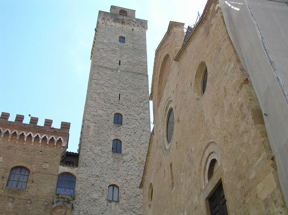 Der Torre Grossa und der Dom, Piazza del Duomo, San Gimignano, Siena. Autor und Copyright Marco Ramerini