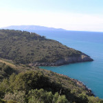 La costa fra Punta Lividonia e Cala Grande sullo sfondo l'isola del Giglio, Monte Argentario, Grosseto. Author and Copyright Marco Ramerini