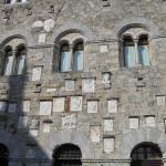 Particolare della facciata del Palazzo Pretorio, con gli stemmi dei Podestà, Massa Marittima, Grosseto. Author and Copyright Marco Ramerini